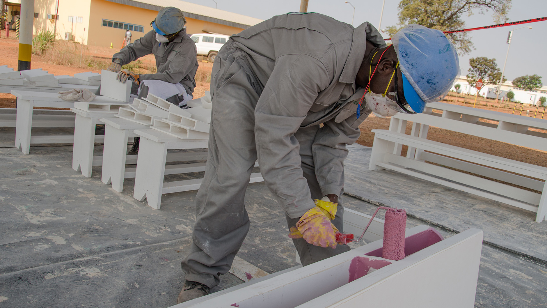 Employees of EEPCI contractor SENEV Tchad finishing a set of desks for local villages