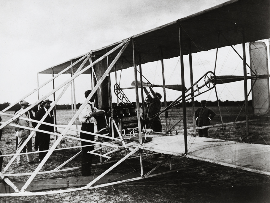 The Wright brothers with plane model