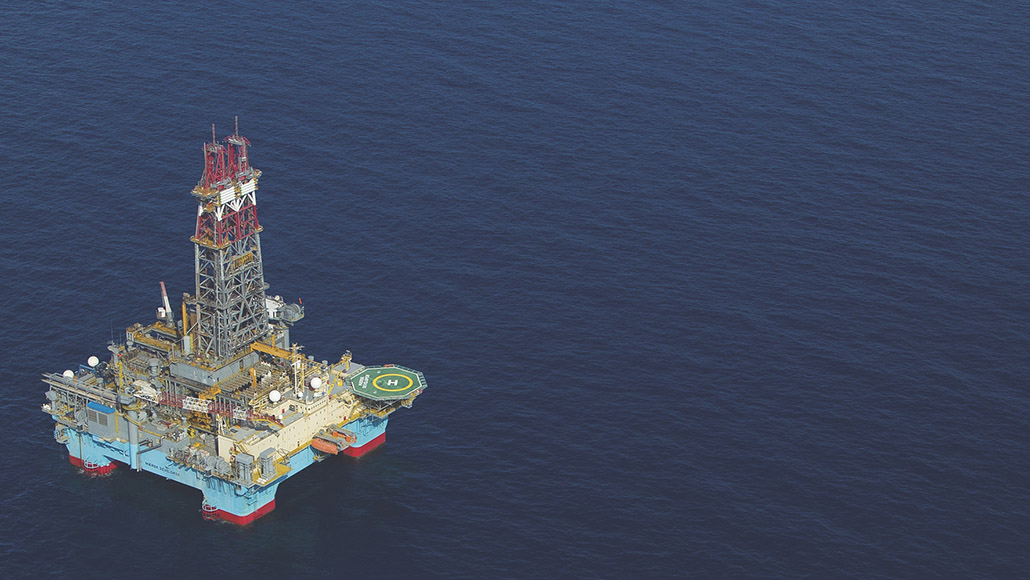 Aerial view of ExxonMobil oil rig in the ocean.