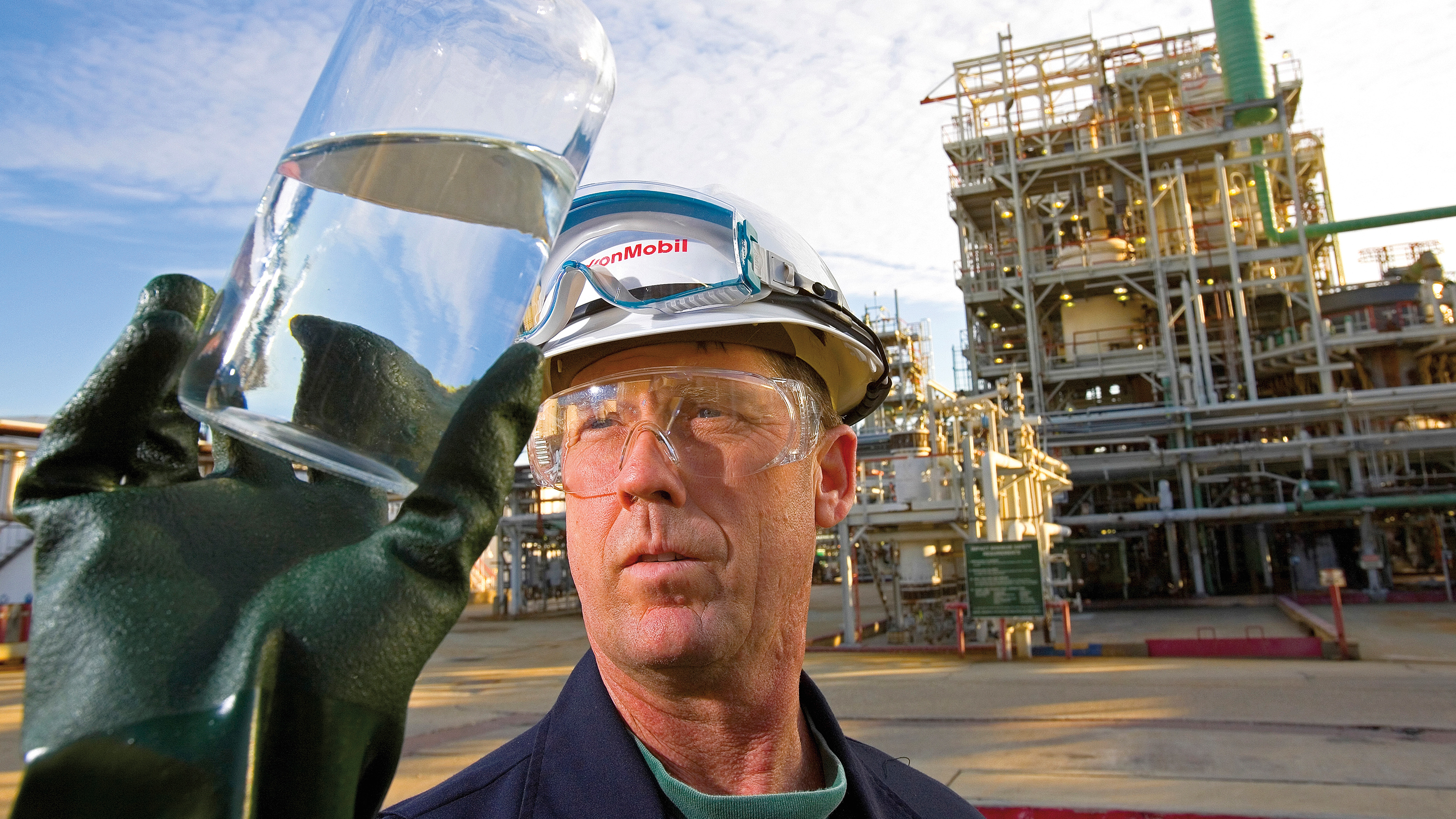 Chemical plant worker inspecting bottle